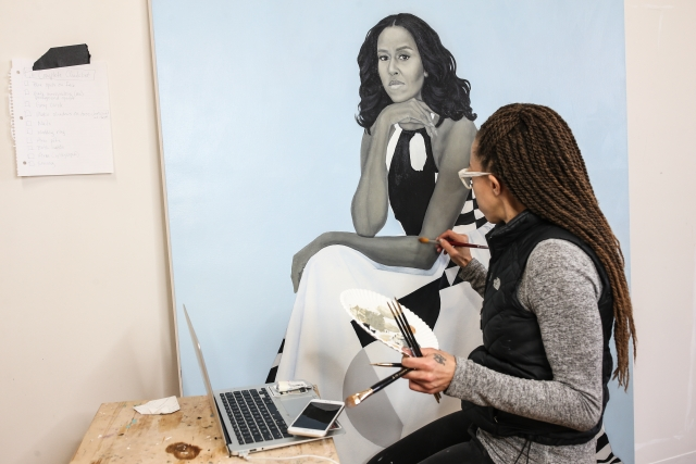 Artist painting Michelle Obama