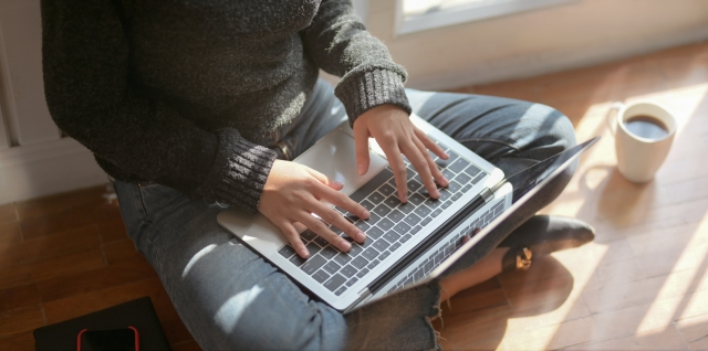 Photo of a person working on a laptop