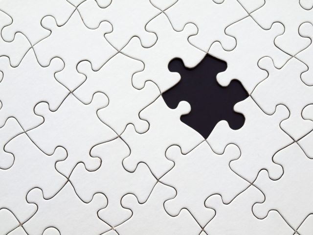 Photo of a puzzle with a missing piece