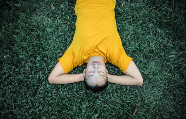 man resting on grass