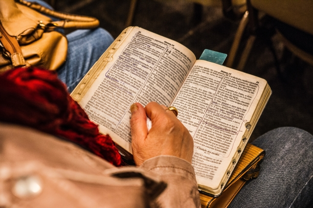 Image of person reading religious text