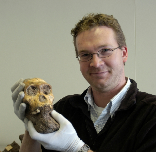 Jeremy DeSilva holding a skull
