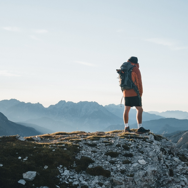 Photo of a hiker standing on a cliff