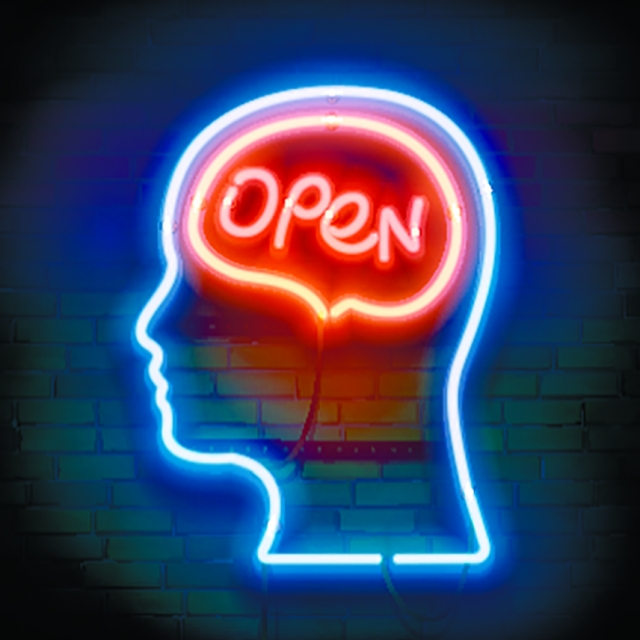 "neon sign depicting a human head with ""open"" written on the area of the brain"