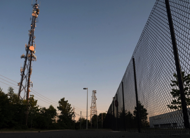 High frequency tower and chainlink fence