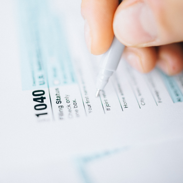 Person filling out tax forms