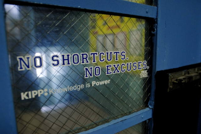 """sign on window reading """"No shortcuts, no excuses."""""""