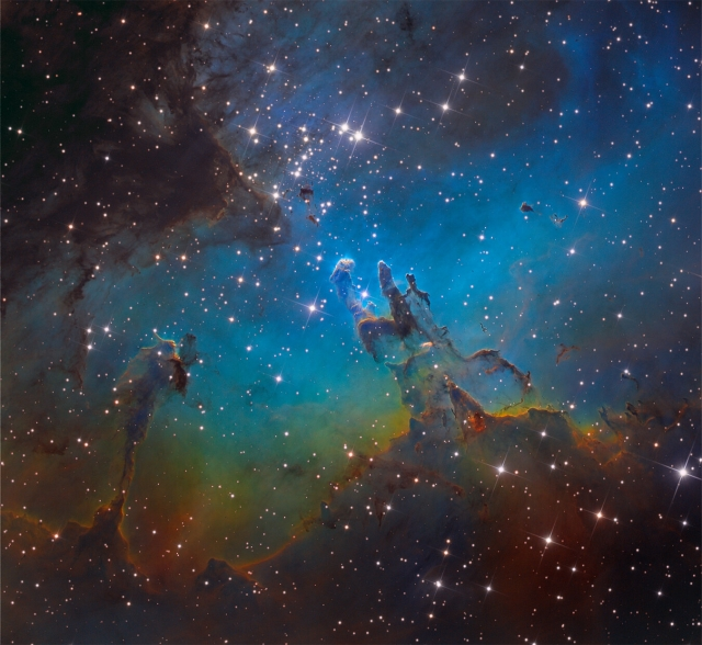 A star cluster around 2 million years young surrounded by natal clouds of dust and glowing gas, M16 is also known as The Eagle Nebula.