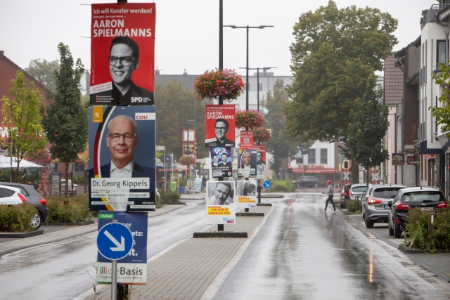 Huerth, NRW, Germany 08 29 2021, several SPD, CDU and others election posters and billboards in a village street, fixed on street lamp mast.